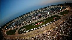 Texas Motor Speedway will host its first Saturday night NASCAR Sprint Cup Series race in the track's 15-year history in 2011, and the IndyCar race scheduled there will also change from a 500-kilometer race to two Twin 275s.