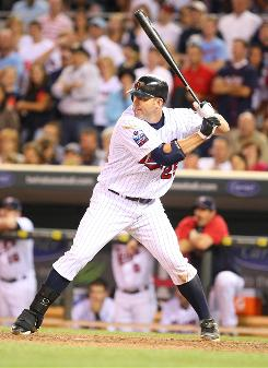 Jim Thome blasts a two-run homer over the right-field bleachers in the bottom of the 10th inning to send the the Twins to a 7-6 win over the White Sox.