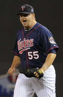 Twins pitcher Matt Capps celebrates after the final out of Minnesota's 7-6 win over the White Sox.