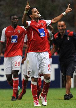 Sporting Braga's Matheus celebrates after scoring against Sevilla during their Champions League first-leg match.