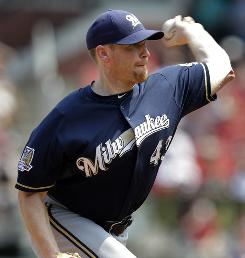 Brewers' Randy Wolf allows just three hits over 8 1/3 innings against the Cardinals.