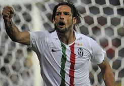 Juventus striker Amauri celebrates his game-winning goal in stoppage time during the first leg of his side's Europa League playoff match against Sturm Graz.