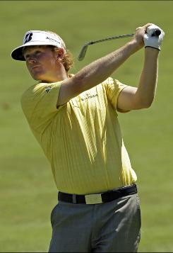 Brandt Snedeker watches his approach shot on the ninth hole Friday during the second round of the Wyndham Championship in Greensboro, N.C. Snedeker finished with a 65 to grab a share of the lead with Arjun Atwal.
