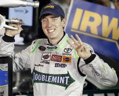 Kyle Busch holds up three fingers indicating his third race won in four days at Bristol Motor Speedway. Busch won Saturday's Sprint Cup Series race to complete an unprecedented sweep of all three national events in the same week.