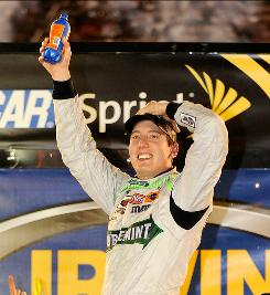 Kyle Busch celebrates after winning the Sprint Cup Series' Irwin Tools Night Race. Busch also won the Nationwide Series and Camp World Truck Series events at Bristol.