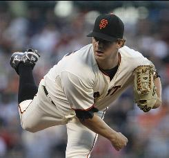 San Francisco pitcher Matt Cain ended a three-start winless stretch with a victory over the Reds Monday.