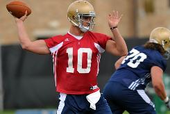 Notre Dame quarterback Dayne Crist will be a key to new coach Brian Kelly's quick-strike offense this season.