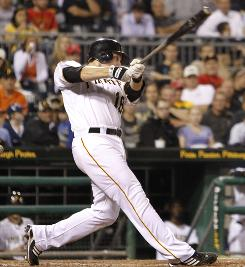 The Pirates' Neil Walker drives in the go-ahead runs in the seventh inning. Walker accounted for three of Pittsburgh's four RBI.