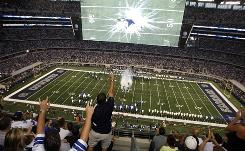 The Dallas Cowboys packed 105,000-plus fans in their new $1.25 billion stadium for their Sept. 2009 game against the New York Giants in Arlington, Texas. The Cowboys have the NFL's highest franchise value.