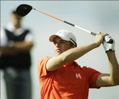 Oklahoma State's Morgan Hoffmann, teeing off on the eighth hole during his third-round match Thursday, faces teammate Peter Uihlein in Friday's quarterfinals.