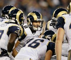 Sam Bradford (8) leads the huddle during his first start as an NFL quarterback.