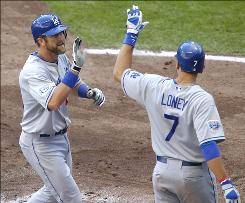 The Dodgers' Casey Blake, left, gets a high-five from Matt Loney after Blake's two-run homer in the sixth inning.