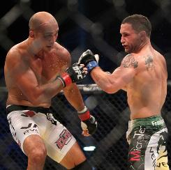 Frankie Edgar, right, defeated BJ Penn during their UFC 112 lightweight bout in Abu Dhabi on April 10. They will fight again Saturday night in Boston at UFC 118.
