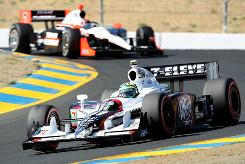 Tony Kanaan races ahead of Brazilian countryman Helio Castroneves during practice for the Grand Prix of Sonoma.