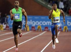 U.S. sprinter Tyson Gay, left, outruns Jamaica's Yohan Blake and the rest of the field down the stretch to win the men's 100 meters in Brussels.