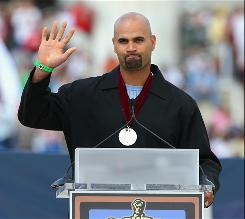 "St. Louis Cardinals slugger Albert Pujols acknowledes the crowd after he was presented with a Hope Award during Fox News personality Glenn Back's ""Restoring Honor"" rally in front of the Lincoln Memorial."