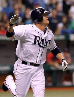 Dan Johnson watches his game-winning home run leave the yard in the bottom of the 10th inning against the Red Sox.