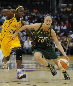 Storm guard Sue Bird, right, drives to the basket against the Sparks' Marie Ferdinand-Harris. Bird had 15 points and four assists to help Seattle win 81-66 and finish off a first-round sweep of Los Angeles.