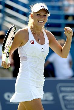 Caroline Wozniacki of Denmark celebrates Saturday after capturing the Pilot Pen championship with a victory against Nadia Petrova. Wozniacki has won two tournaments in a row, and she will be the top seed at the U.S. Open.