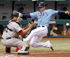 Tampa Bay first baseman Carlos Pena slides home as Boston catcher Victor Martinez waits for the catch in the sixth inning. Pena was out, but the Rays won 5-3.