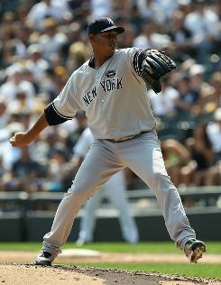 Yankees rookie starting pitcher Ivan Nova delivers during New York's 2-1 win over the White Sox in Chicago.