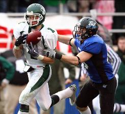 Northwest Missouri State's Jake Soy, left, scores the touchdown that helped defeat Grand Valley State 30-23 in last year's Division II championship game.