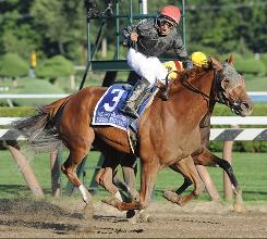 Jockey Alan Garcia celebrates as Persistently (3) crosses the finish line to win the $300,000 Personal Ensign race at Saratoga Race Course.