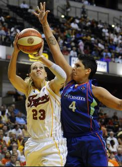 Indiana guard Katie Douglas, left, going up for a shot against New York forward Janel McCarville, had 11 points and five assists to help the Fever even the Eastern Conference semifinal series 1-1.