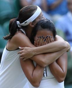 Yaroslava Shvedova, left, embraces partner Vania King after the duo won the women's doubles title at Wimbledon. King and Shvedova paired up for the first time only weeks earlier.