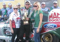 Courtney Force, right, joins sister Brittany and her father, John, in a victory celebration from earlier this season at The Strip at Las Vegas Motor Speedway.
