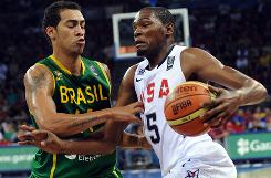 Team USA's Kevin Durant drives on Brazilian defender Marcus Vieira during their preliminary round matchup in Istanbul.