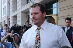 Roger Clemens leaves the federal courthouse in Washington after Monday's arraignment.