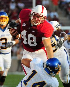 Owen Marecic scored four touchdowns as a fullback for Stanford in 2009. He has immersed himself in playbooks lately and will also start at linebacker in the season opener.