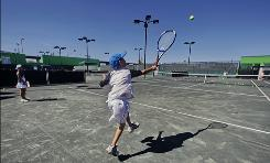 Andrew Nussbaum, 10, from Scarsdale, N.Y., trains at the John McEnroe Tennis Academy in New York. The academy will officially welcome its first class, including Nussbaum, who will make at least two trips weekly from his suburban home to the revamped, 20-court, $18 million tennis complex on Randall's Island. 