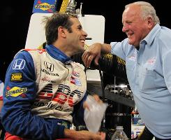 Vitor Meira, left, and team owner A.J. Foyt share a laugh after their ninth-place finish at Chicagoland Speedway.