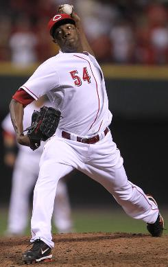 The Reds are using rookie Aroldis Chapman, who earned his first big-league victory Wednesday vs. the Brewers, out of the bullpen.