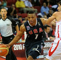 Russell Westbrook, left, drives the ball against Aren Davoudi Chegani of Iran during their game at the world championships. All 12 players on the U.S. roster scored as the Americans defeated Iran 88-51 to secure the top seed in the knockout round of the tournament.