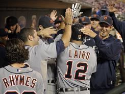 Detroit Tigers Gerald Laird is mobbed in the Tigers dugout after hitting a solo home run off Minnesota Twins pitcher Nick Blackburn during the 13th inning Thursday in Minneapolis. Detroit won 10-9.