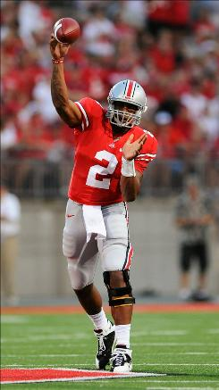Ohio State quarterback Terrelle Pryor completed 17 of 25 passes for 247 yards and three touchdowns as the Buckeyes beat the Marshall Thundering Herd 45-7.
