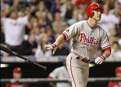 Phillies second baseman Chase Utley hits a grand slam in the seventh inning of the Phillies' 12-11 victory against the Rockies on Thursday. Utley drove in six runs.