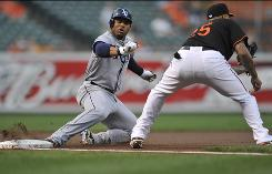 Tampa Bay left fielder Carl Crawford slides safely into third base for a triple, one of his three hits in a 4-1 win over the Baltimore Orioles.
