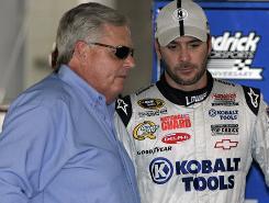 Jimmie Johnson, right, talks with team owner Rick Hendrick in the Charlotte Motor Speedway garage area last season.