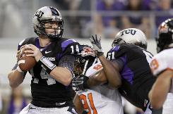 TCU quarterback Andy Dalton made up for two interceptions by running for two scores and throwing for another at Dallas Cowboys Stadium.