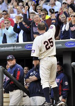 Jim Thome (25) takes a curtain call to acknowledge the Minnesota crowd after swatting his 584th career home run against the Rangers.