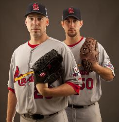 Cardinals pitchers Chris Carpenter, left, and Adam Wainwright have combined to win 31 games this season.