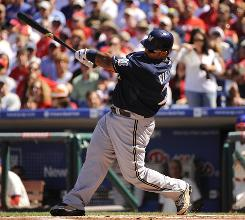 Brewers first baseman Prince Fielder hits a three run home run in the first inning, his 30th of the season.