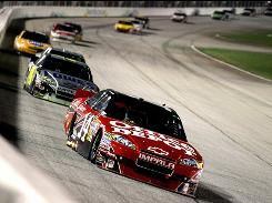 Tony Stewart beat Carl Edwards by 1.316 seconds Sunday night in the Emory Healthcare 500 for his first victory since Oct. 4, 2009.