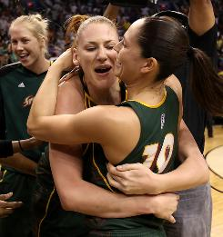 Lauren Jackson, left, and Sue Bird of the Seattle Storm celebrate after defeating the Phoenix Mercury in Game 2 of the Western Conference Finals.