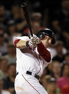 Red Sox rookie Ryan Kalish hits a grand slam against the Rays during the fourth inning. It was Kalish's second grand slam of the season.