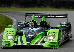Drivers David Brabham and Simon Pagenaud in their Patron Highcroft Honda hold a healthy edge in LMP. Here, they are racing last month in the Mid-Ohio Sports Car Challenge.